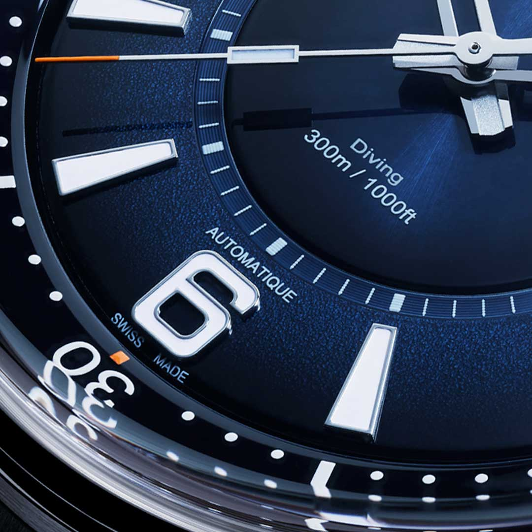 Close up of the different finishes on the gradient blue dial.
