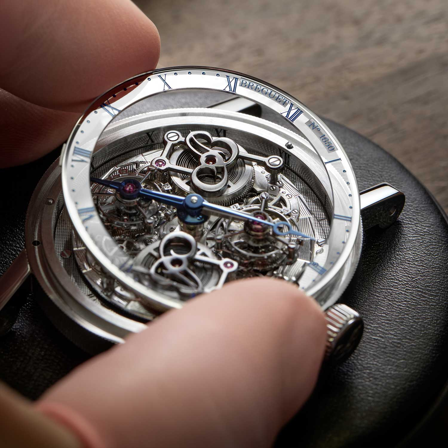 Placing the large domed sapphire that sits over the face of the Breguet Classique Double Tourbillon 5345 Quai de L'horloge
