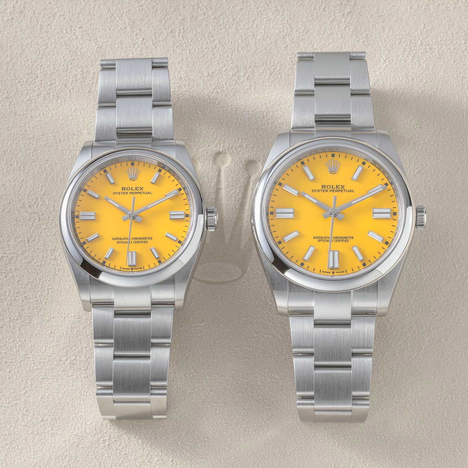 The 36mm and 41mm sizes of the 2020 Rolex Oyster Perpetual side-by-side, seen here with the yellow dial (©Revolution)