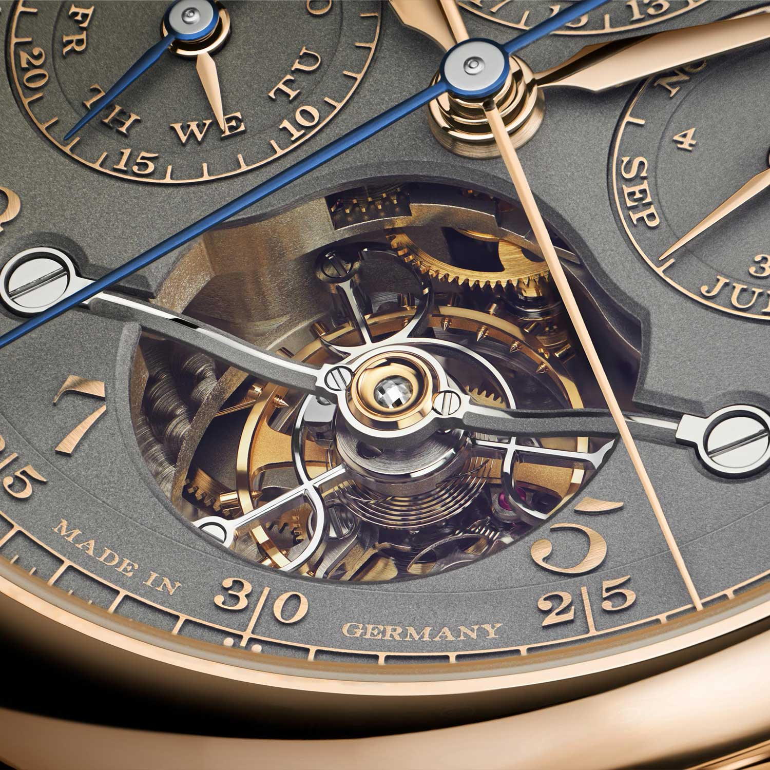 """The extravagant curved tourbillon bridge of the Tourbograph Perpetual Honeygold """"Homage to F. A. Lange"""" is black polished to exacting standards, by hand"""