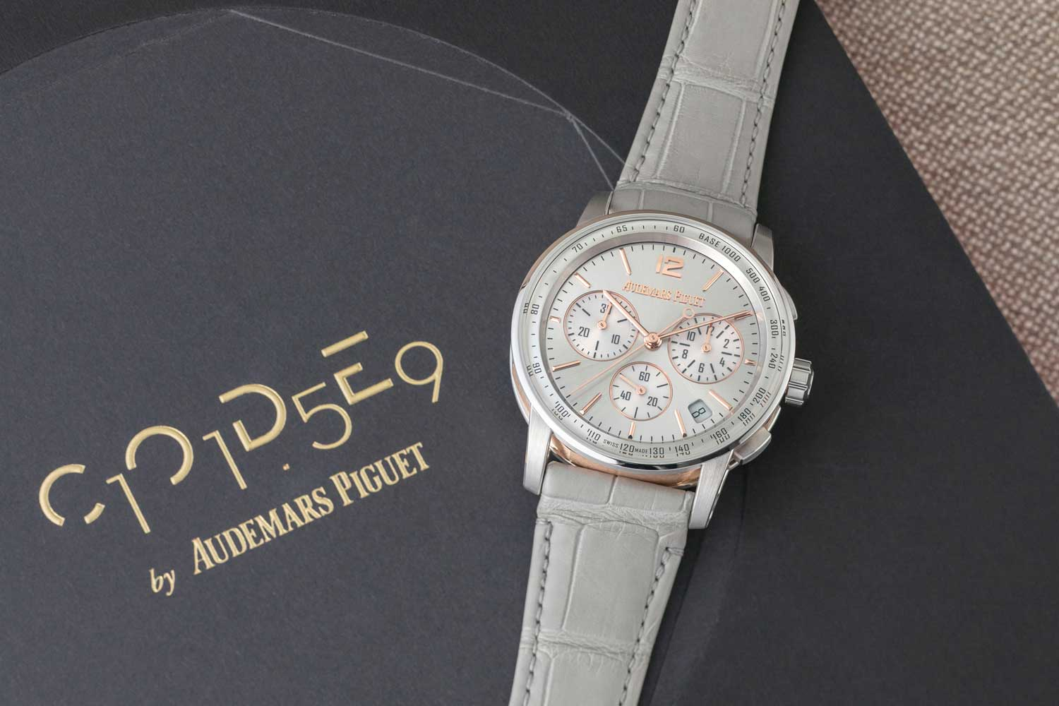 The Code 11.59 by Audemars Piguet Selfwinding Chronograph in 41mm, ref. 26393CR.OO.A009CR.01 with a grey lacquered dial with sunburst pattern, powered by the all new Manufacture Calibre 4401, a column-wheel-activated vertical clutch chronograph (©Revolution)