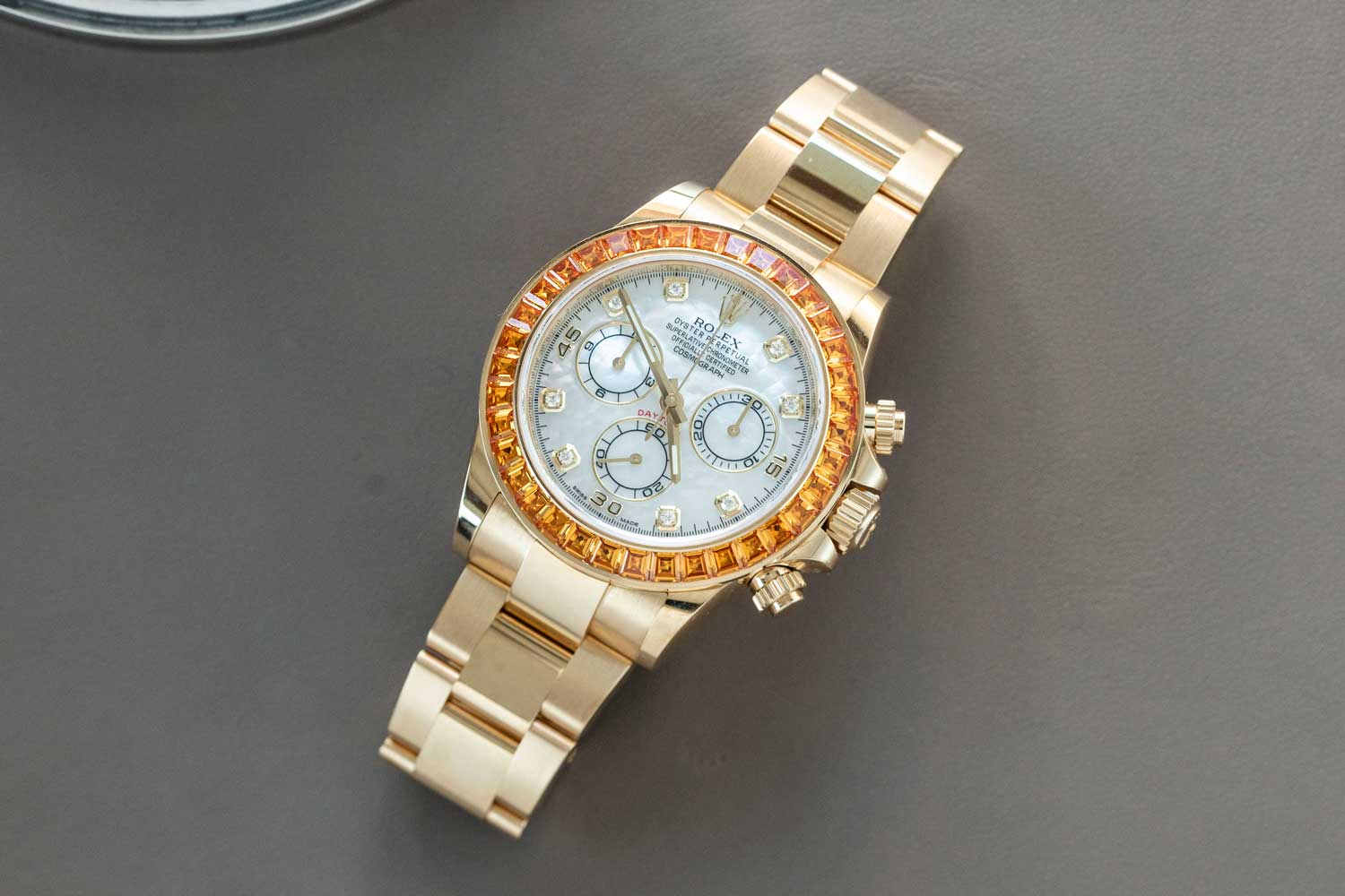 The Rolex Daytona ref. 116578 SACO with an orange sapphire-set bezel (©Revolution)