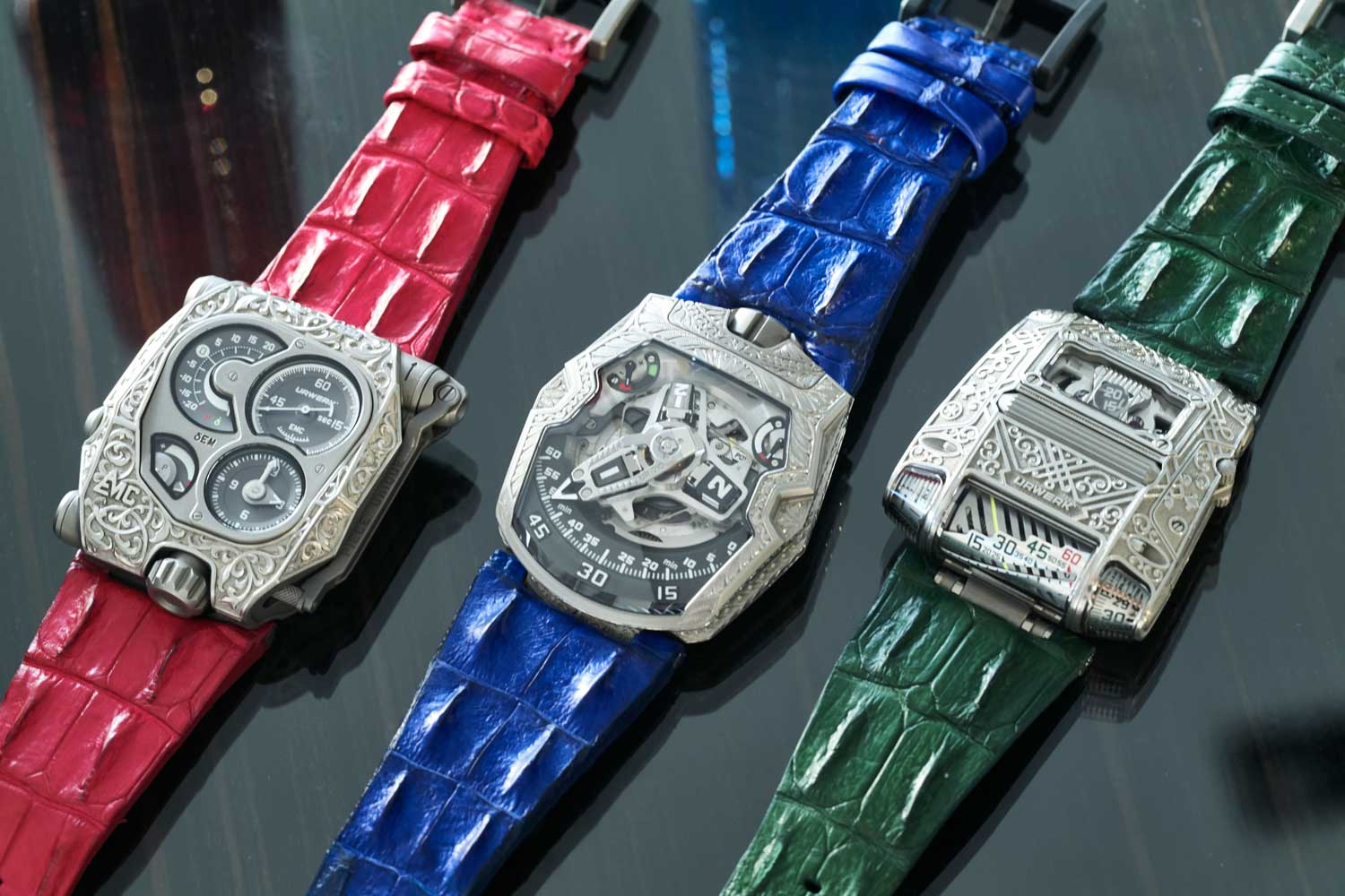 Santa Laura's collection of URWERK pièces unique engraved by Florian Güllert, the EMC, 210 and 111; the UR-111 is even made with personalized green numerals (©Revolution)