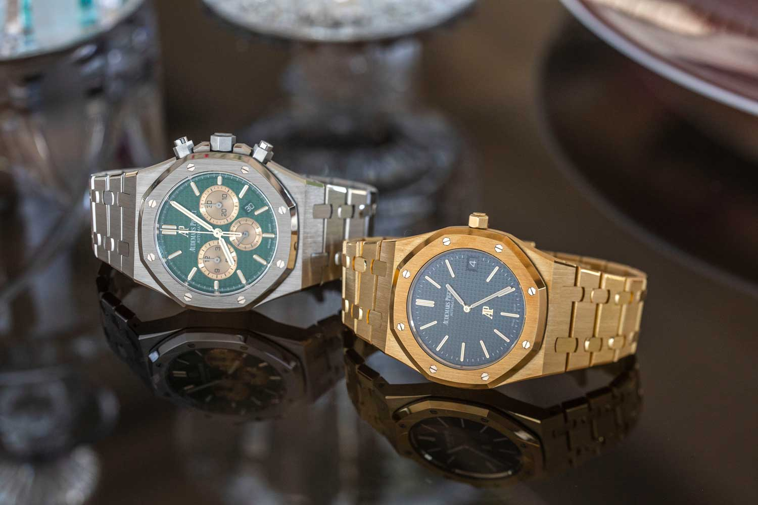 The Royal Oak Chronograph The Hour Glass Edition in platinum with a green dial and contrasting yellow-gold subdials and indexes, which was made in just 20 examples and the Audemars Piguet Royal Oak Extra-Thin The Hour Glass Limited Edition in yellow-gold with a green dial, made in a series of 50 watches (©Revolution)