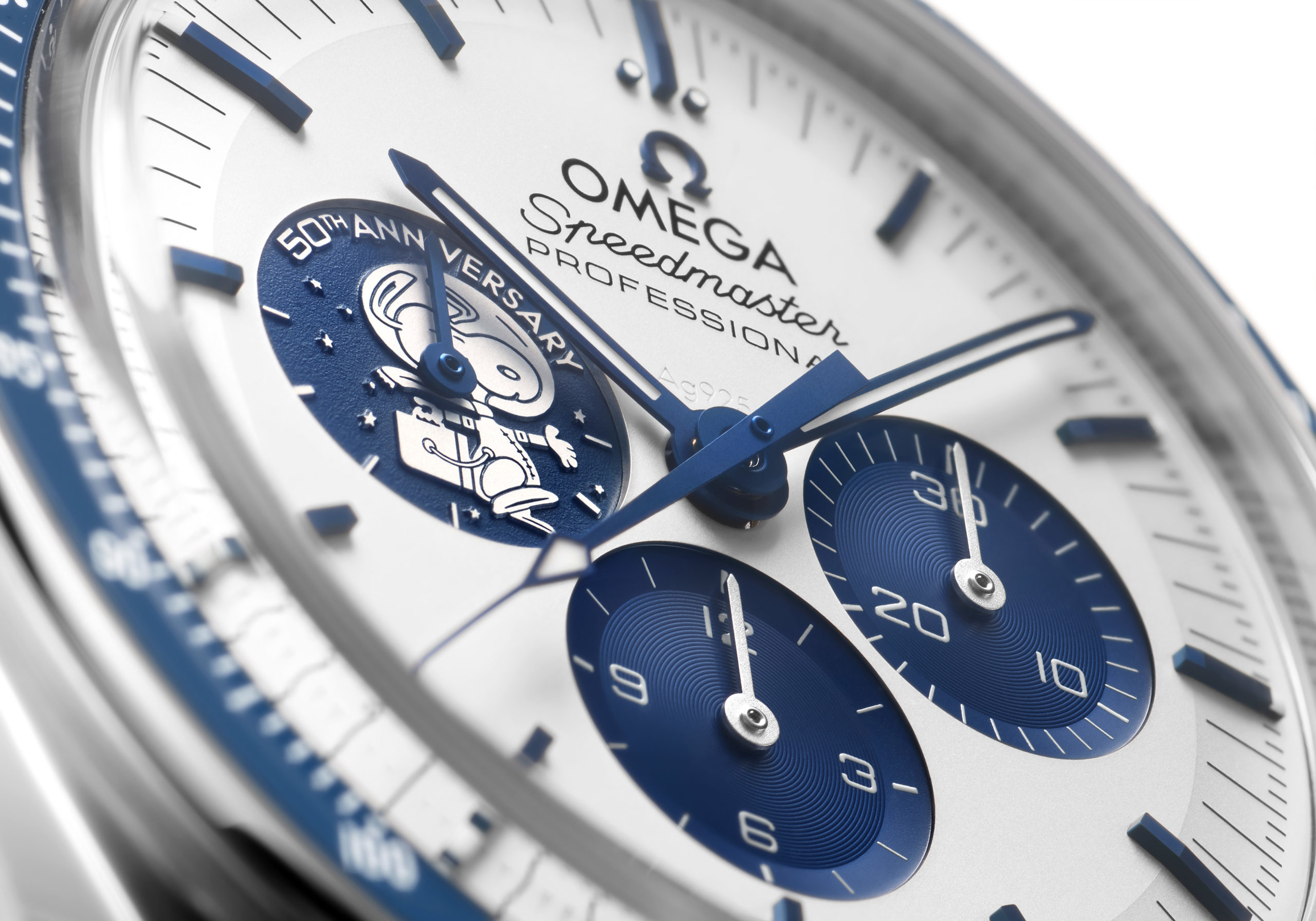 Snoopy takes takes center stage on the new watch as an embossed silver medallion on the blue subdial at 9 o'clock
