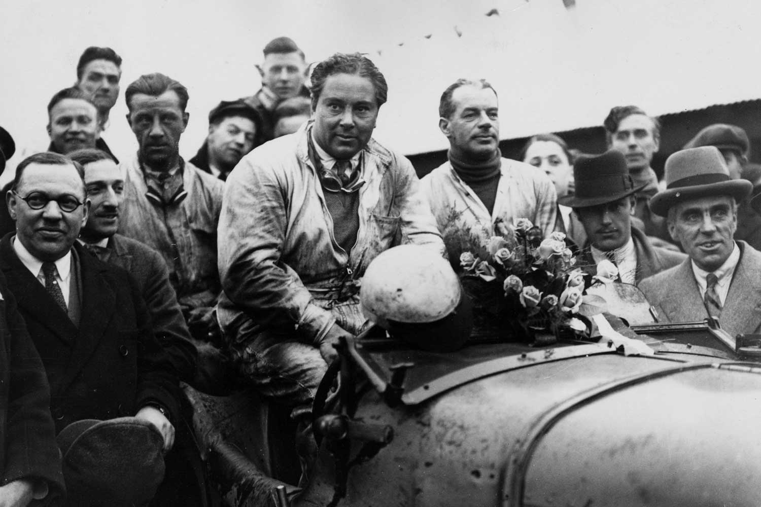 1930: Woolf Barnato (centre) and F O Clement in their Bentley after winning the Double Twelve Race at Brooklands. (Photo by Central Press/Hulton Archive/Getty Images)
