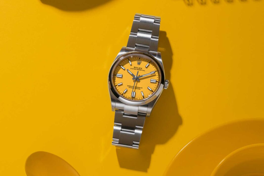 Rolex Oyster Perpetual 36 with a yellow dial and an Oyster bracelet.