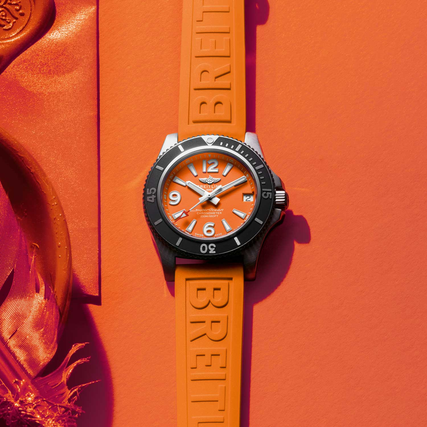 Breitling Superocean Automatic 36 with an orange dial and orange rubber strap.