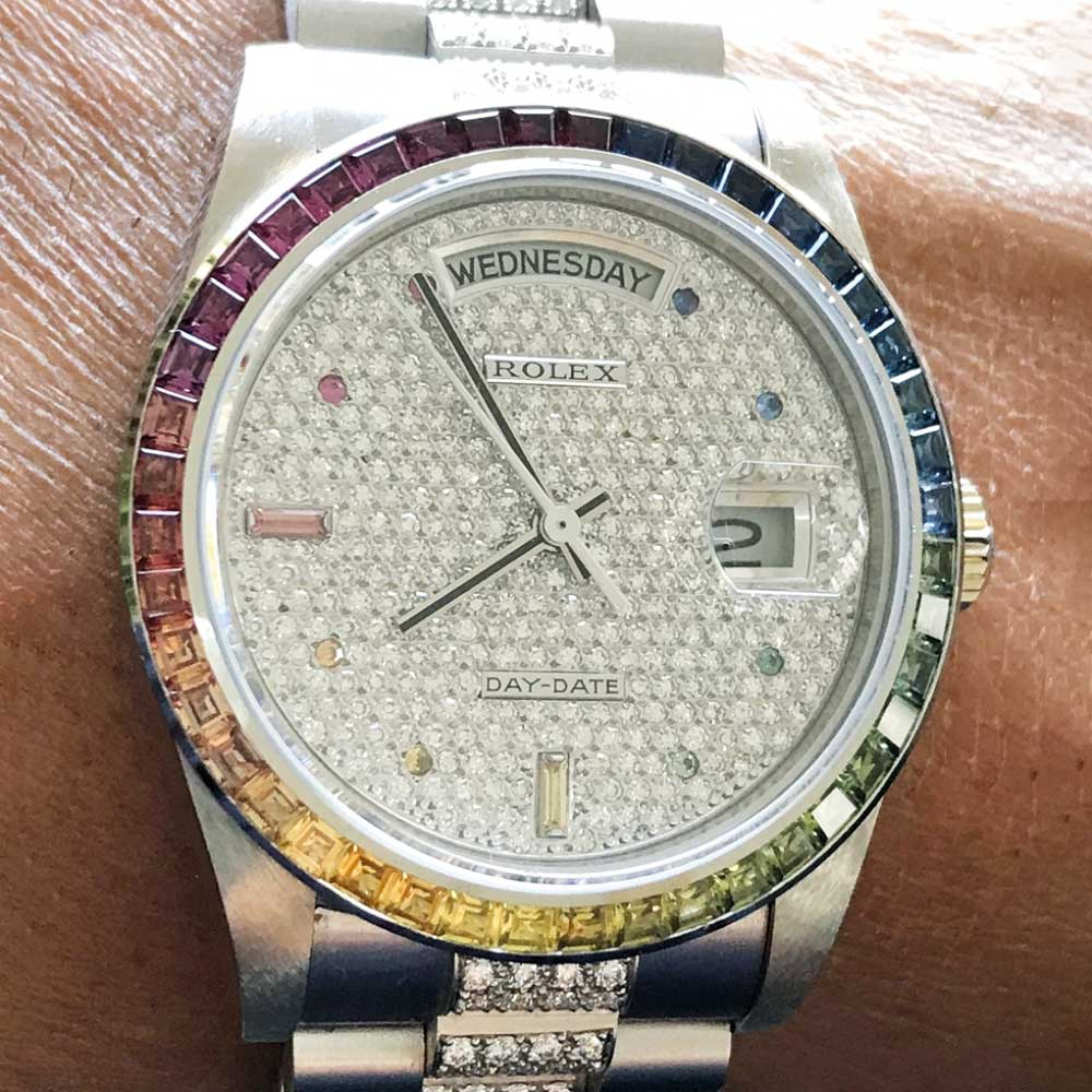 A unique rainbow bezel white gold Day-Date with match rainbow-hued hour markers.