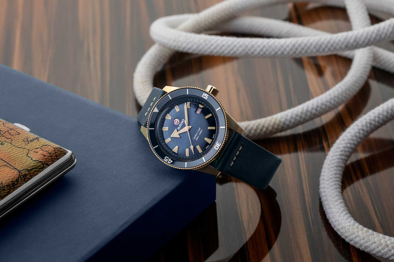 The Captain Cook Bronze in blue with matching ceramic bezels and leather straps (©Revolution)