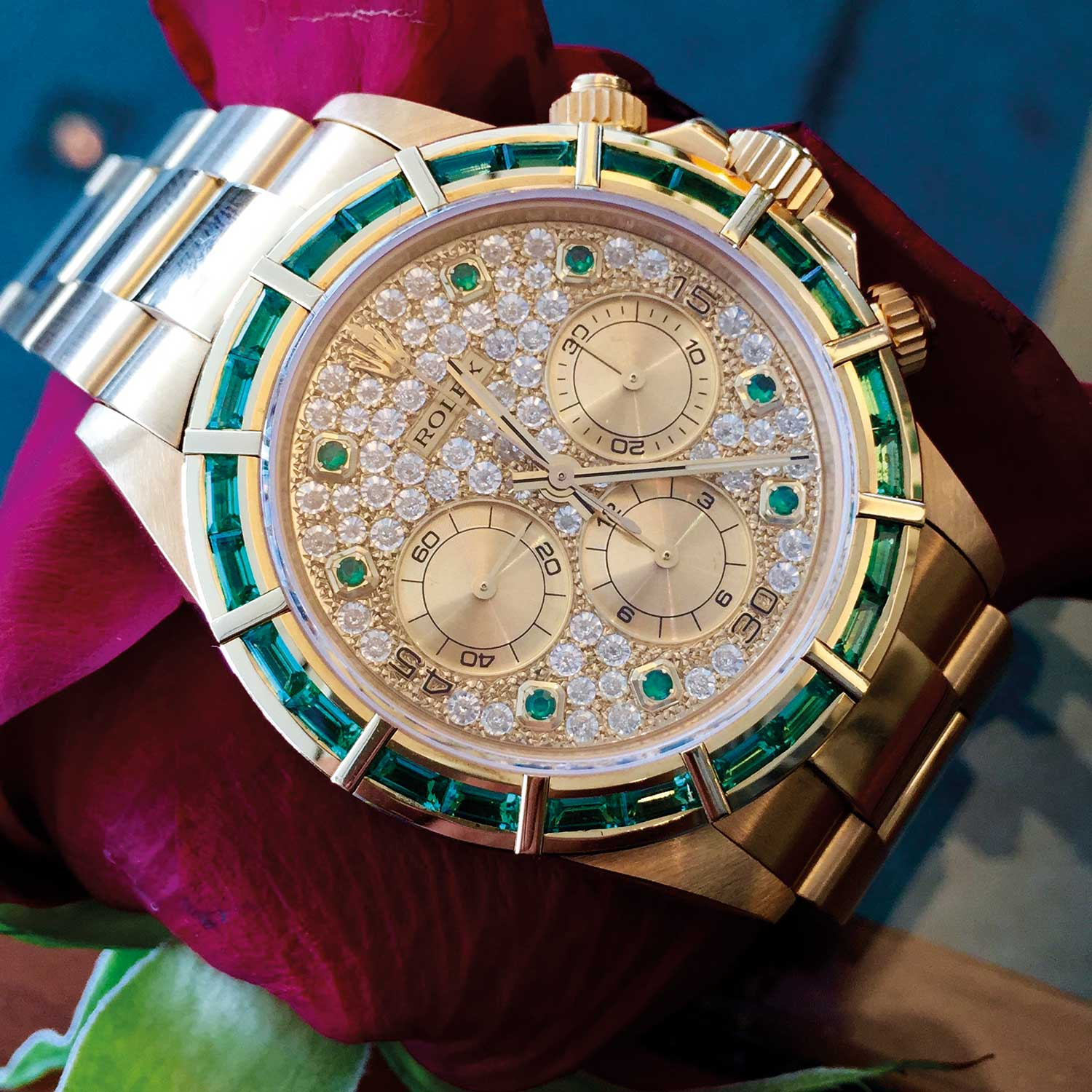 A Rolex Daytona reference 16528 in yellow gold with baguette-cut emerald bezel and emerald hour markers. Confirmed by Rolex as delivered in this configuration and the only one ever seen.