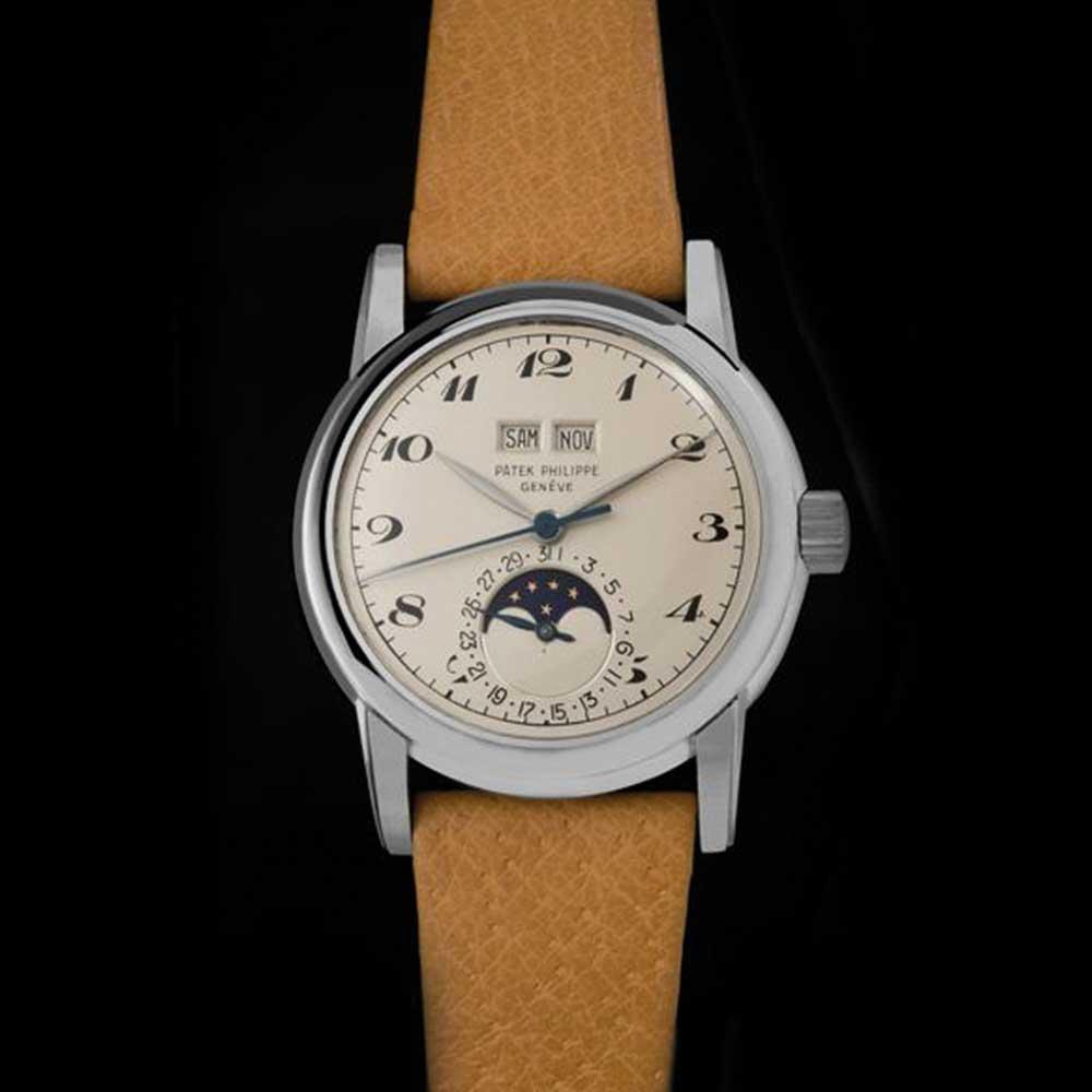 A unique platinum Patek Philippe ref 2497 perpetual calendar with enamel Breguet numerals