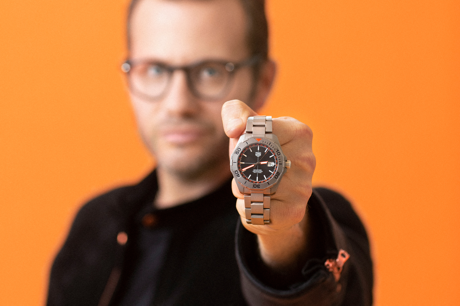 George Bamford with the TAG Heuer X Bamford Watch Department Limited Edition Aquaracer