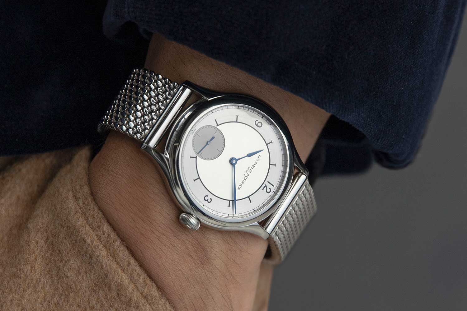 On the wrist: Laurent Ferrier Classic Origin for Revolution & The Rake on the steel beads of rice bracelet (©Revolution)