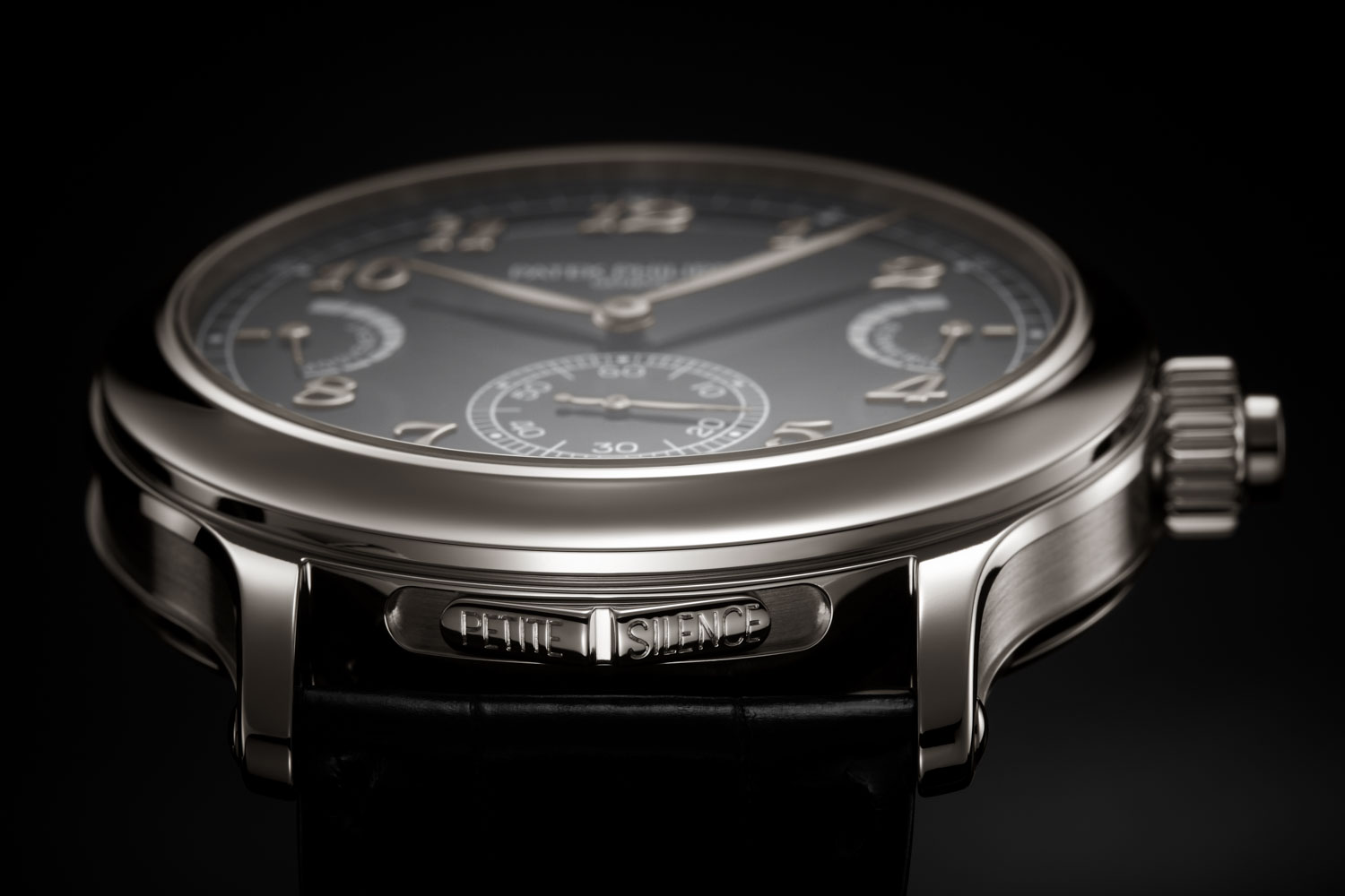 For the Patek Philippe Ref. 6301P Grande Sonnerie the slide switch at 6 o'clock selects the strikework mode (petite sonnerie, grande sonnerie, silence)