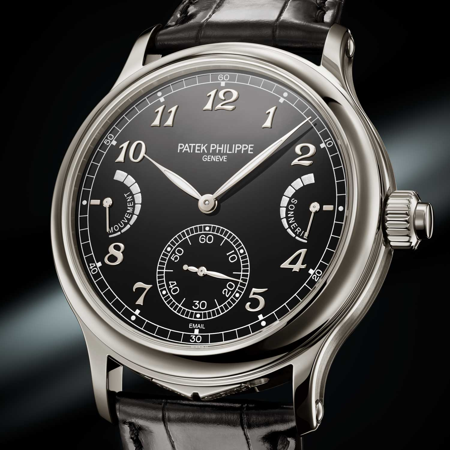 "The 44.8 mm platinum Patek Philippe Ref. 6301P Grande Sonnerie features an 18K gold, black grand feu enamel dial with ""glacé"" finish; applied Breguet numerals in 18K white gold; leaf-shaped hour and minute hands in 18K white gold with luminous coating; subsidiary seconds at 6 o'clock with ""dague"" type hand in white gold, printed railway track seconds scale with luminous 10-second markers; printed railway track minute scale with luminous 5-minute markers ""Cheveu"" type hands in white gold for the power-reserve indicators for the movement and the strikework"
