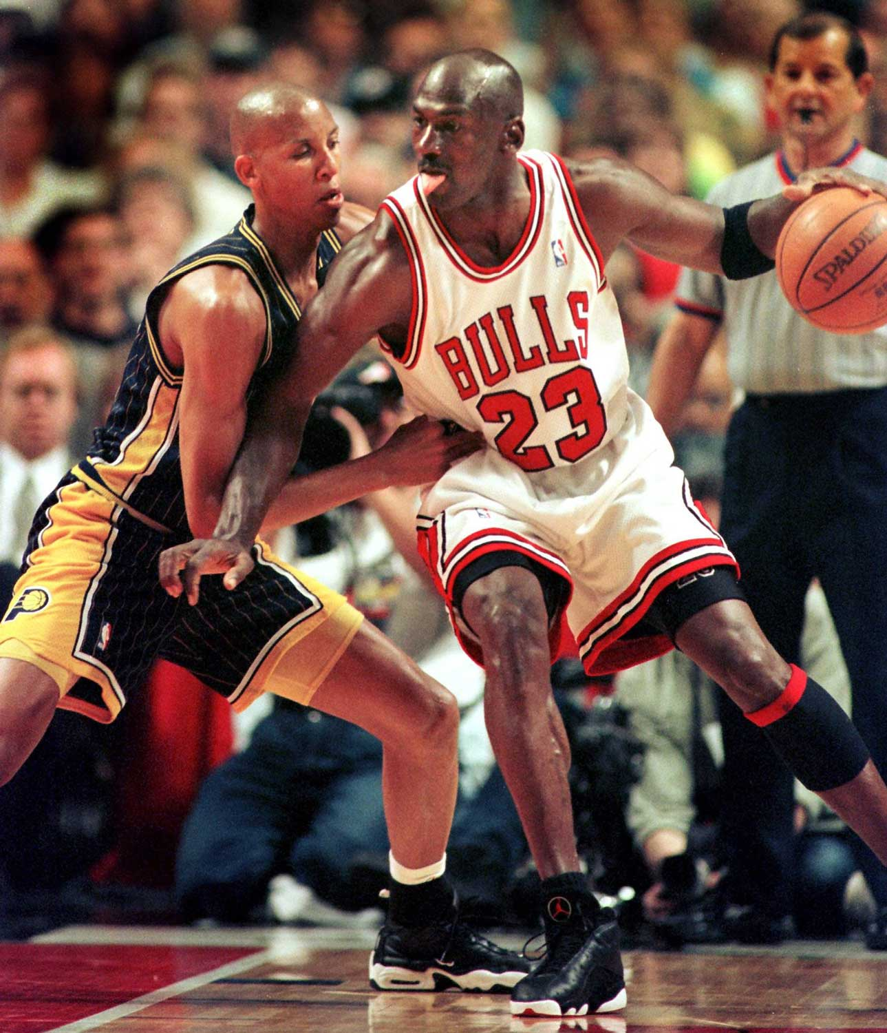 A rookie Reggie Miller, while with the Indiana Pacers squaring off with the one and only, Michael Jordan of the Chicago Bulls