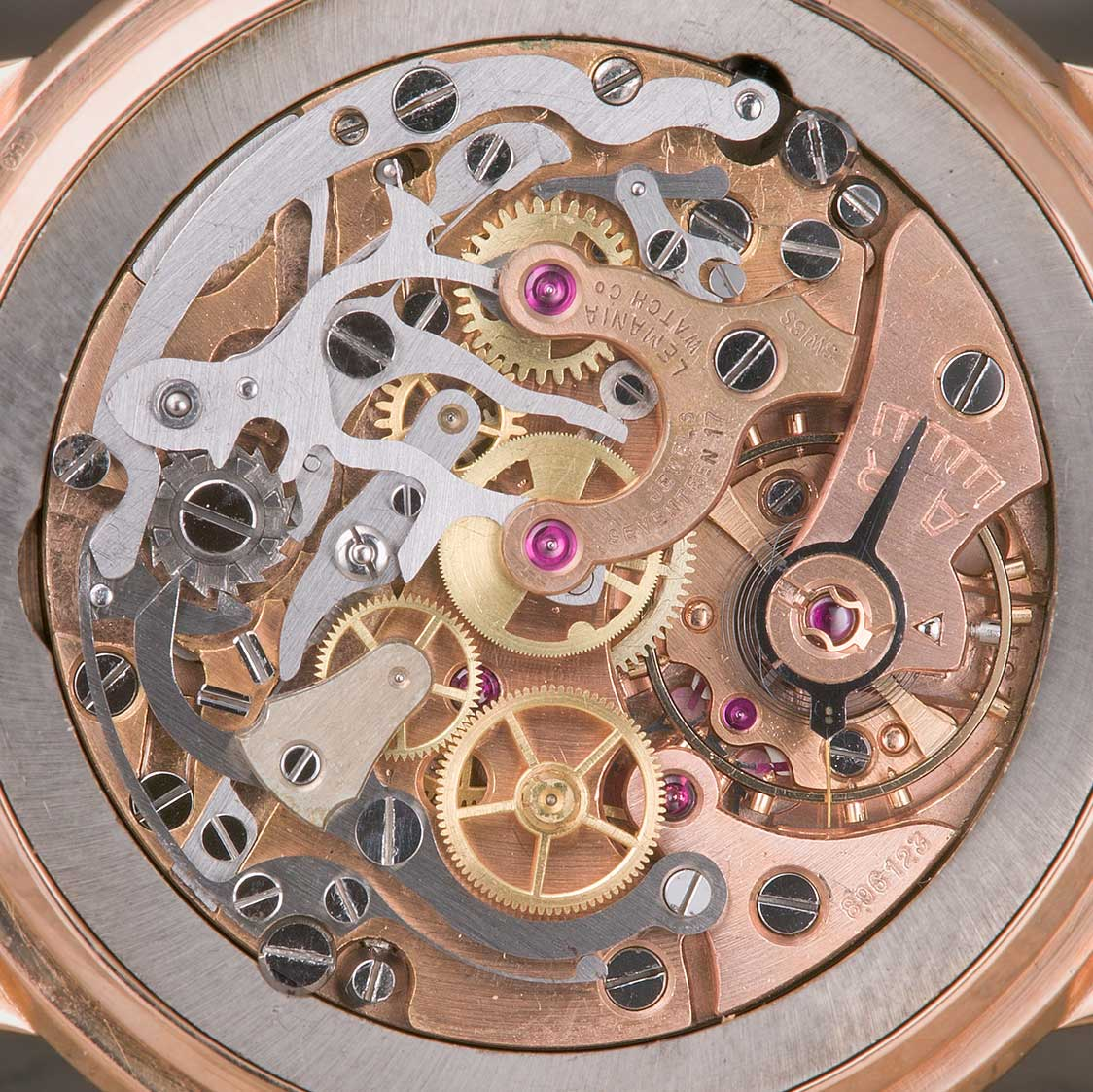 Open caseback on a 1950s Lemania Chronograph in rose gold, showcasing a Lemania 2310 chronograph movement (Image: ninanet.net; SteveG's Watch Launchpad)