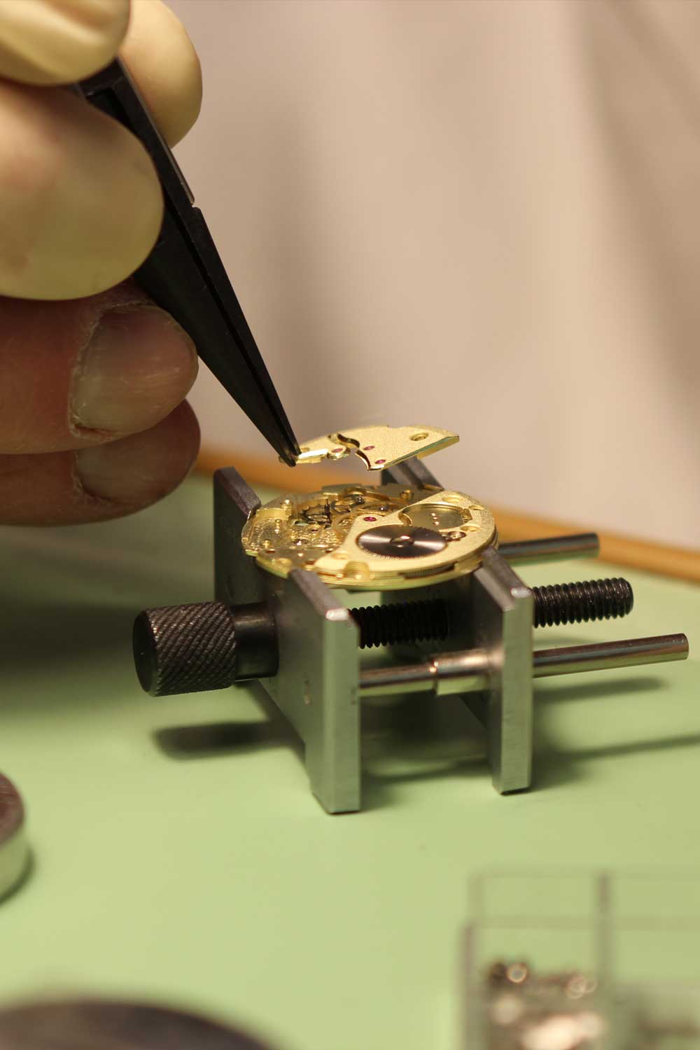 Michiel Holthinrichs gingerly placing a finished bridge onto a movement in the midst of assembly