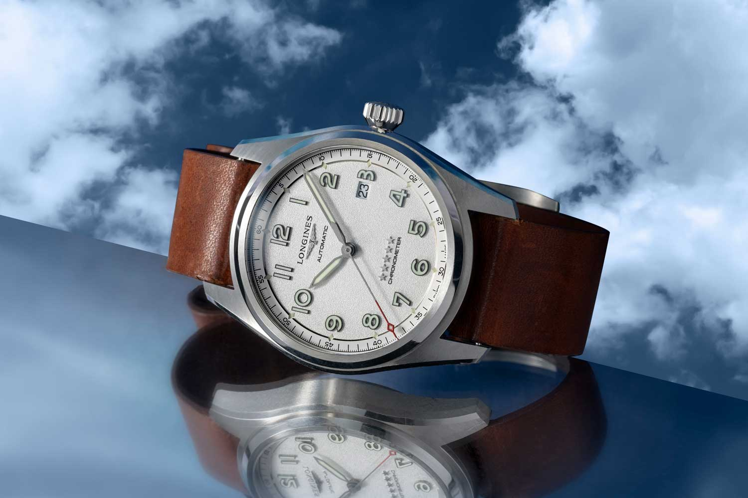 The silver grained dial version of the time only addition to the Spirit collection comes in a 42 and 40mm satin and polished steel case variation; housed inside is an exclusive COSC-certified self-winding movement (L888.4) with silicon hairspring; a domed sapphire glass protects the dial set with Arabic numerals and black sandblasted hands coated with Super-LumiNova®; the watch is seen here on a light brown leather strap (©Revolution)