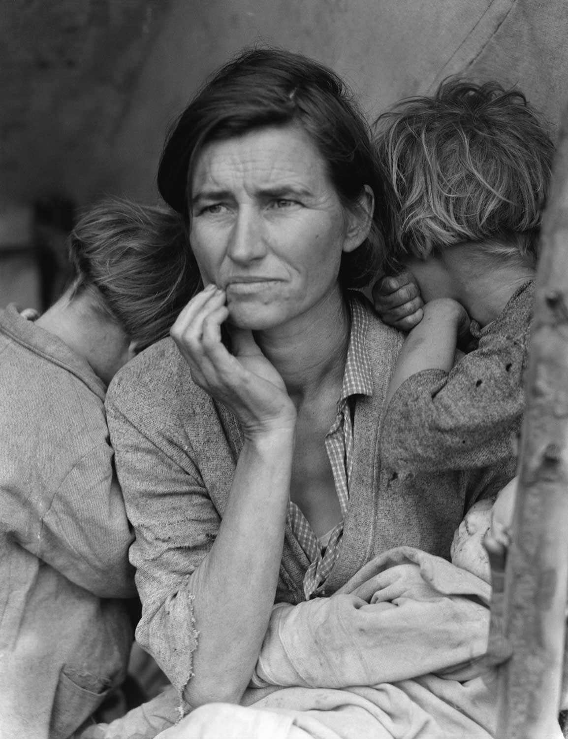 Migrant Mother by Dorothea Lange — A poverty-stricken migrant mother (Florence Owens Thompson, 32) with three young children gazes off into the distance. This photograph, commissioned by the FSA, came to symbolize the Great Depression for many Americans (Getty Images)