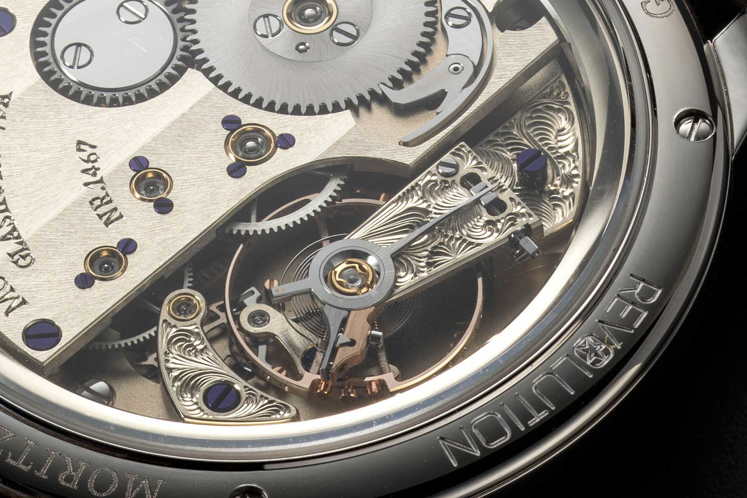 From Moritz Grossmass with love, their balance cock and escapement bridge are engraved by hand to give the watch its ultimate signature (©Revolution)