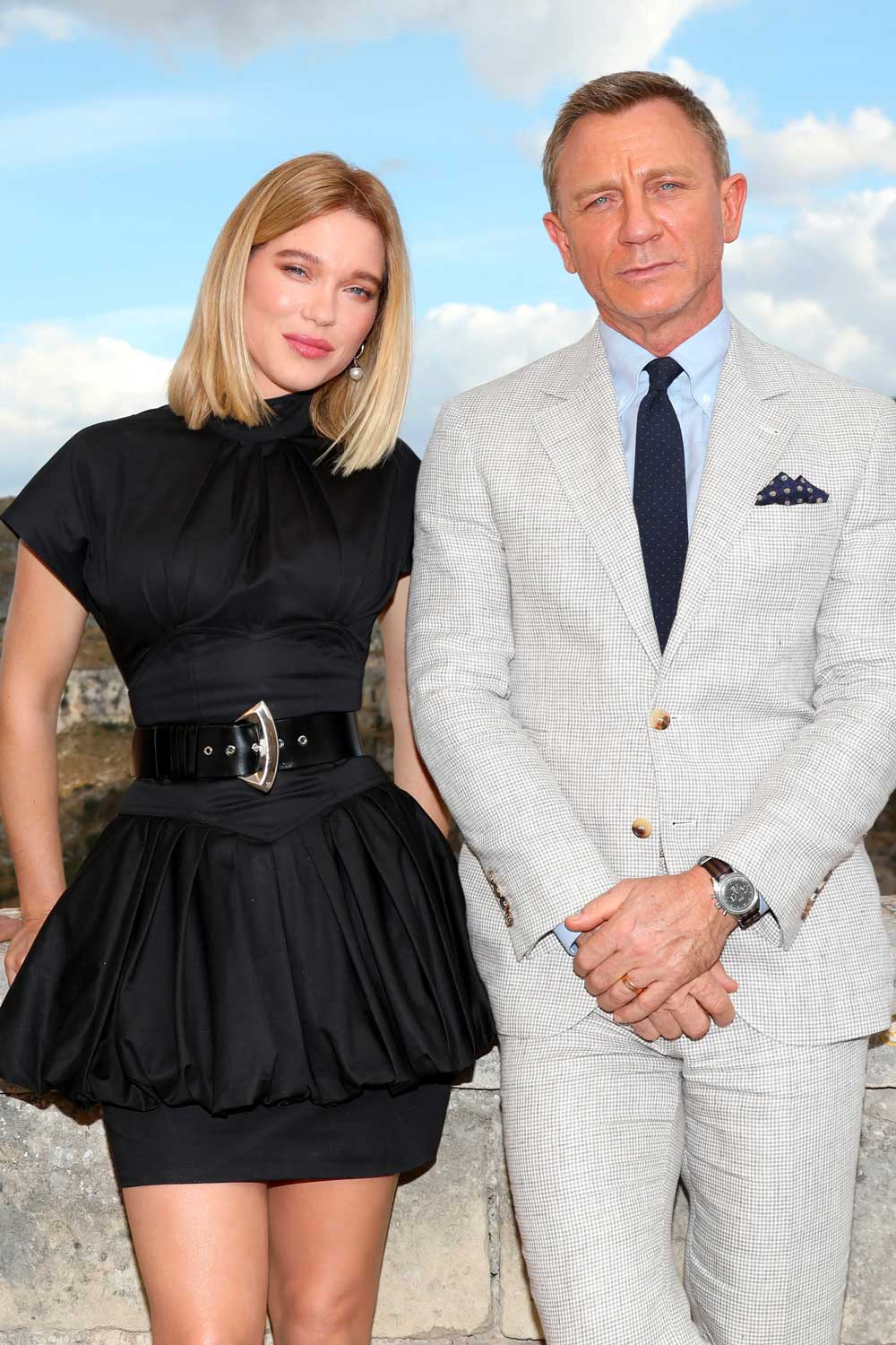 """MATERA, ITALY - SEPTEMBER 09: Actress Léa Seydoux and actor Daniel Craig pose as they arrive on set of the James Bond last movie """"No Time To Die"""" on September 09, 2019 in Matera, Italy. on Craig's wrist in clear view is the 2017 Omega Speedmaster '57 Chronograph from the 1957 Trilogy on a NATO strap (Photo by Franco Origlia/Getty Images)"""