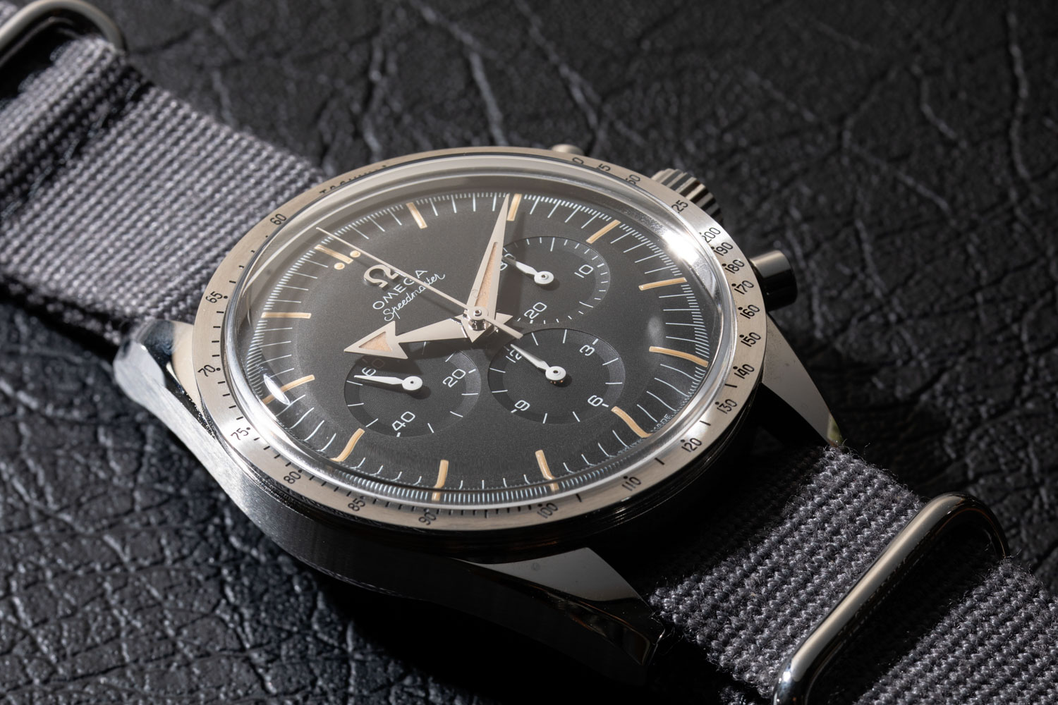 2017 Omega Speedmaster '57 Chronograph from the 1957 Trilogy, seen here on a simple grey NATO strap (©Revolution)