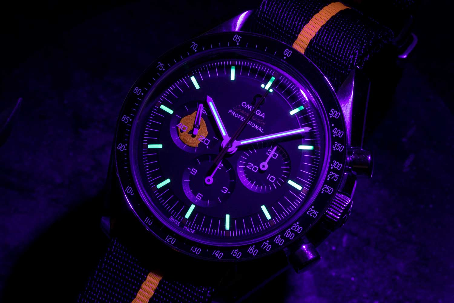 "The hidden luminous Ultraman silhouette painted inside the continuous seconds marker can be seen only when a UV light used on the 2018 Speedmaster Limited Edition 42mm ""Ultraman"" , while in the dark"