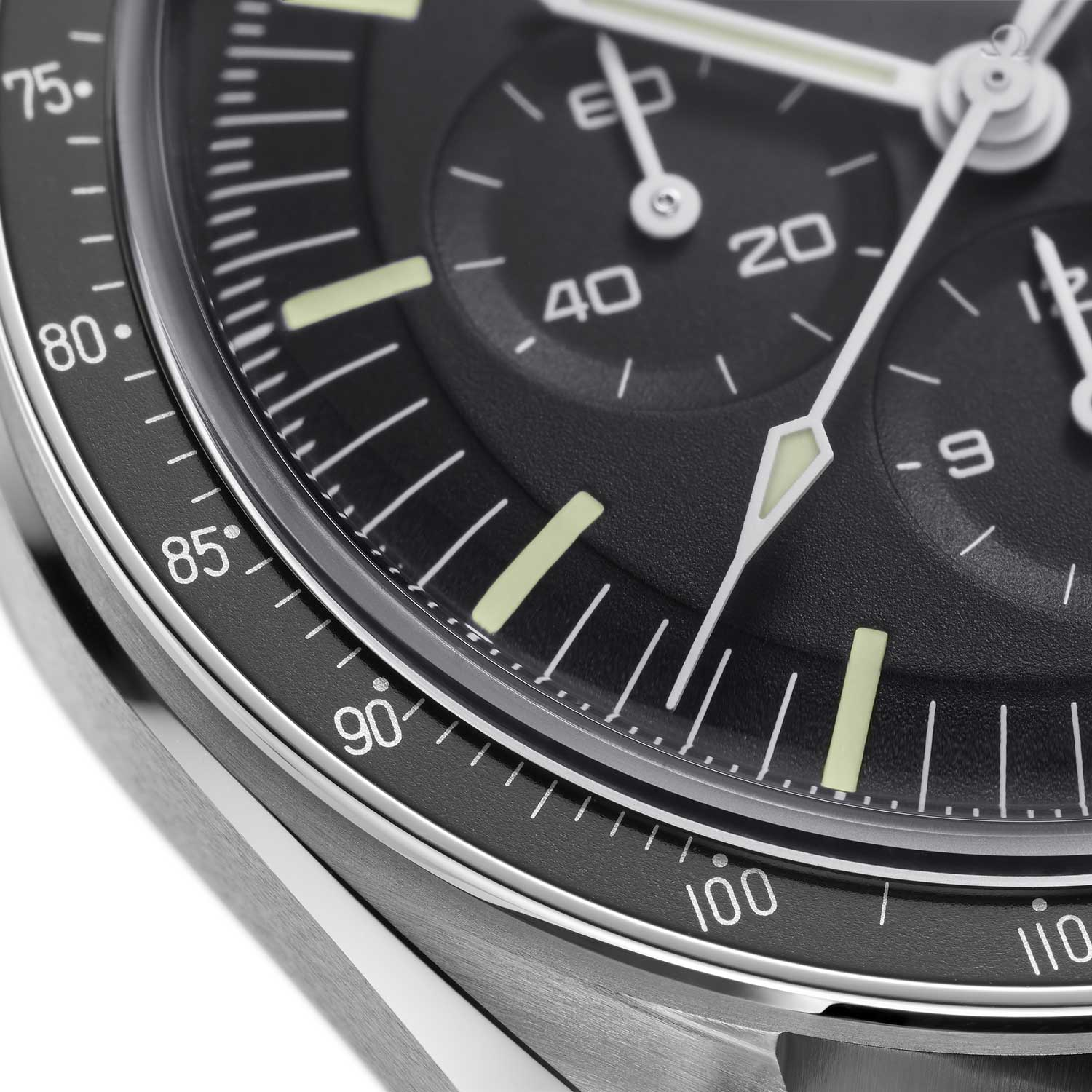 The bezel on 2021 Speedmaster is an anodized aluminum insert that has been given the famous dot over 90 (DON) detail