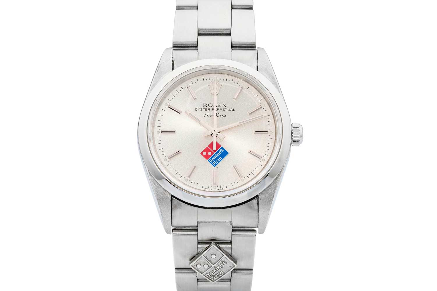 One of the most commonly ordered Rolex watches with specially printed dials was the humble Air King; pictured here is an instance of the Ref. 14000, Air-King with the Domino's Pizza company's logy and as well a metal badge adorning the steel bracelet (Image: Antiquorum)