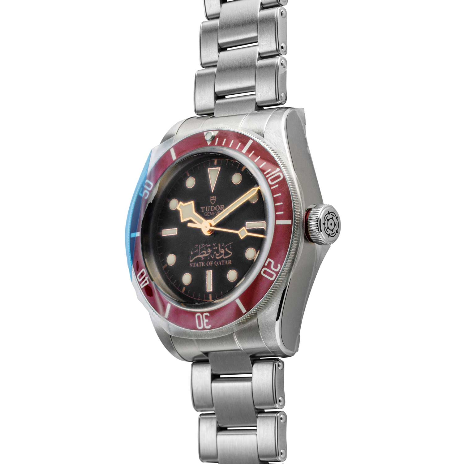 To showcase that the NOS Tudor State of Qatar Black with a burgundy bezel, is in fact NOS, you can see that the watch still has its factory plastic wrapping on in the presented photographs; available for purchase through Shop.Revolution.Watch at the time of publication (©Revolution)