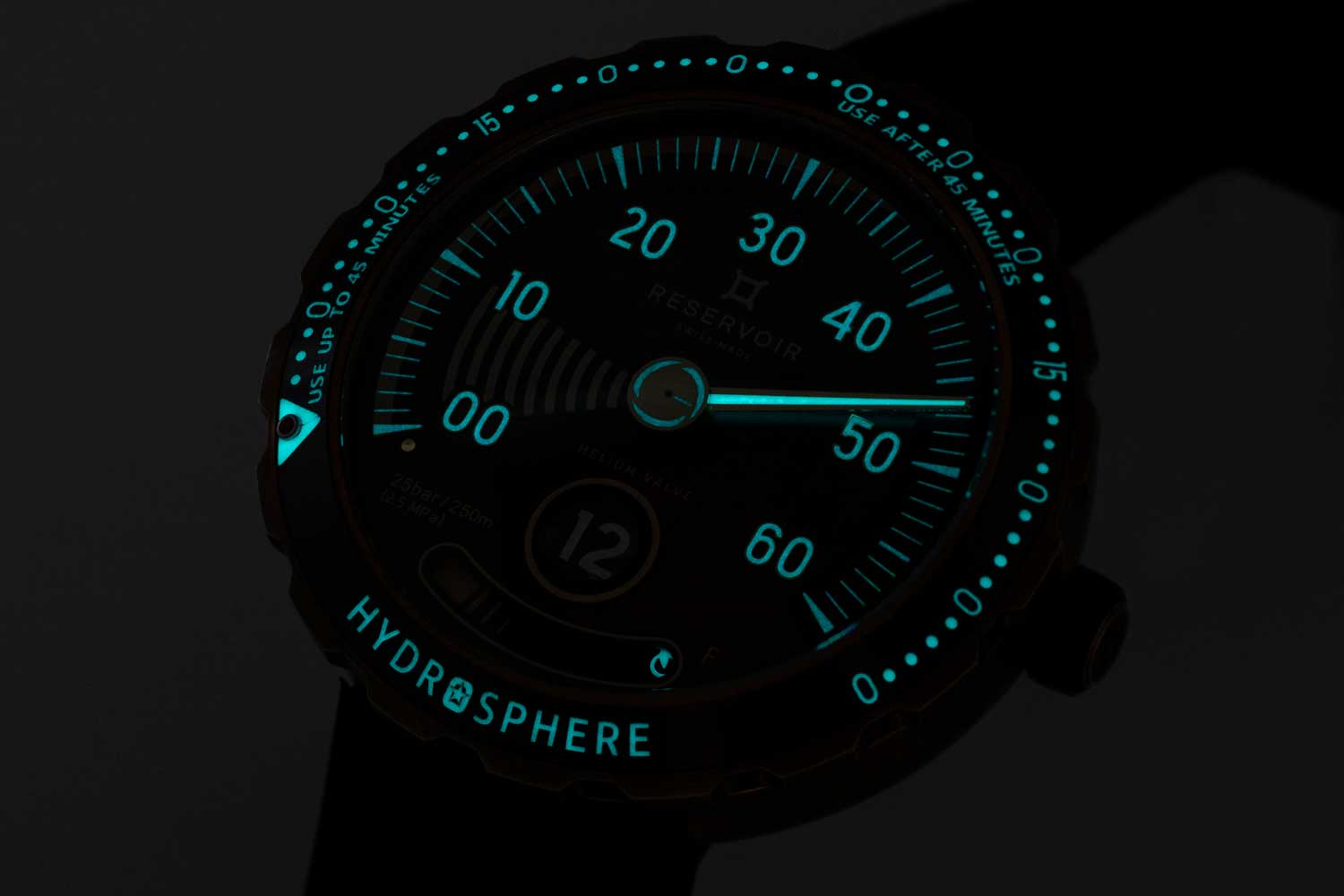 """Lume shot of the luminous dial and bezel on the Reservoir Hydrosphere Bronze x Revolution """"The Maldives Edition"""" (©Revolution)"""