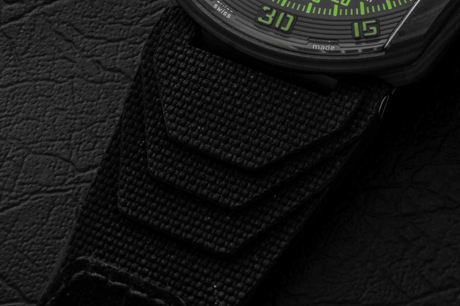 The damnably cool strap of the Project Falcon that is moulded, curved and textured by a process called Vulcarbone (©Revolution)
