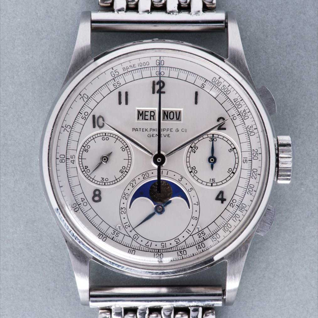 Patek Philippe perpetual calendar chronograph ref. 1518 in stainless steel with moon phases, applied Arabic hour markers, tachymeter scale and bracelet, which sold for CHF11,002,000 with Phillips during their Geneva Watch Auction: FOUR in 2016 (Image: Phillips.com)