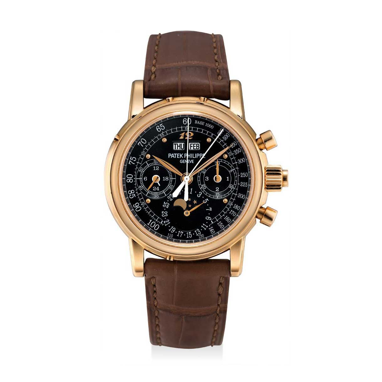 Formerly in the collection of Eric Clapton, CBE, a pink gold Patek Philippe ref. 5004 perpetual calendar split seconds chronograph wristwatch with a special black tachymetre dial and applied Breguet numeral at 12 o'clock; the watch is presently the property The Hour Glass permanent collection (Image: phillips.com)
