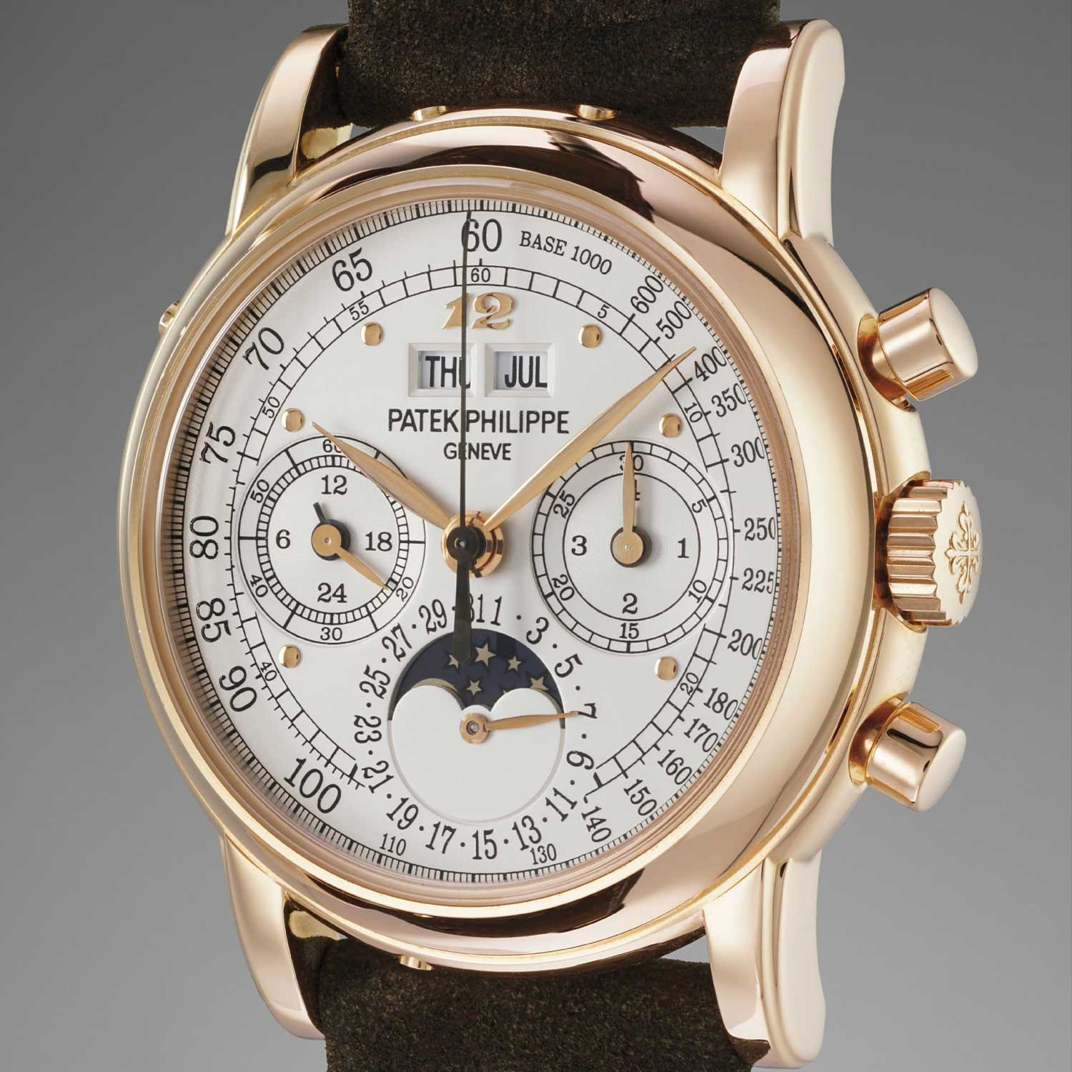 Formerly in the collection of Eric Clapton, CBE, a pink god Patek Philippe ref. 3970 erpetual calendar chronograph wristwatch with a silvered tachymeter dial and applied Breguet numeral at 12 o'clock (phillips.com)