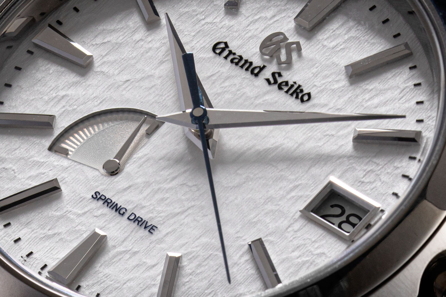 The Zen Reductionist dial of the Grand Seiko 'Snowflake' SBGA211 has large beautifully finished sword hands, a flame-blued seconds hand, a power-reserve indicator at 8:30 and a date window at three o'clock (©Revolution)