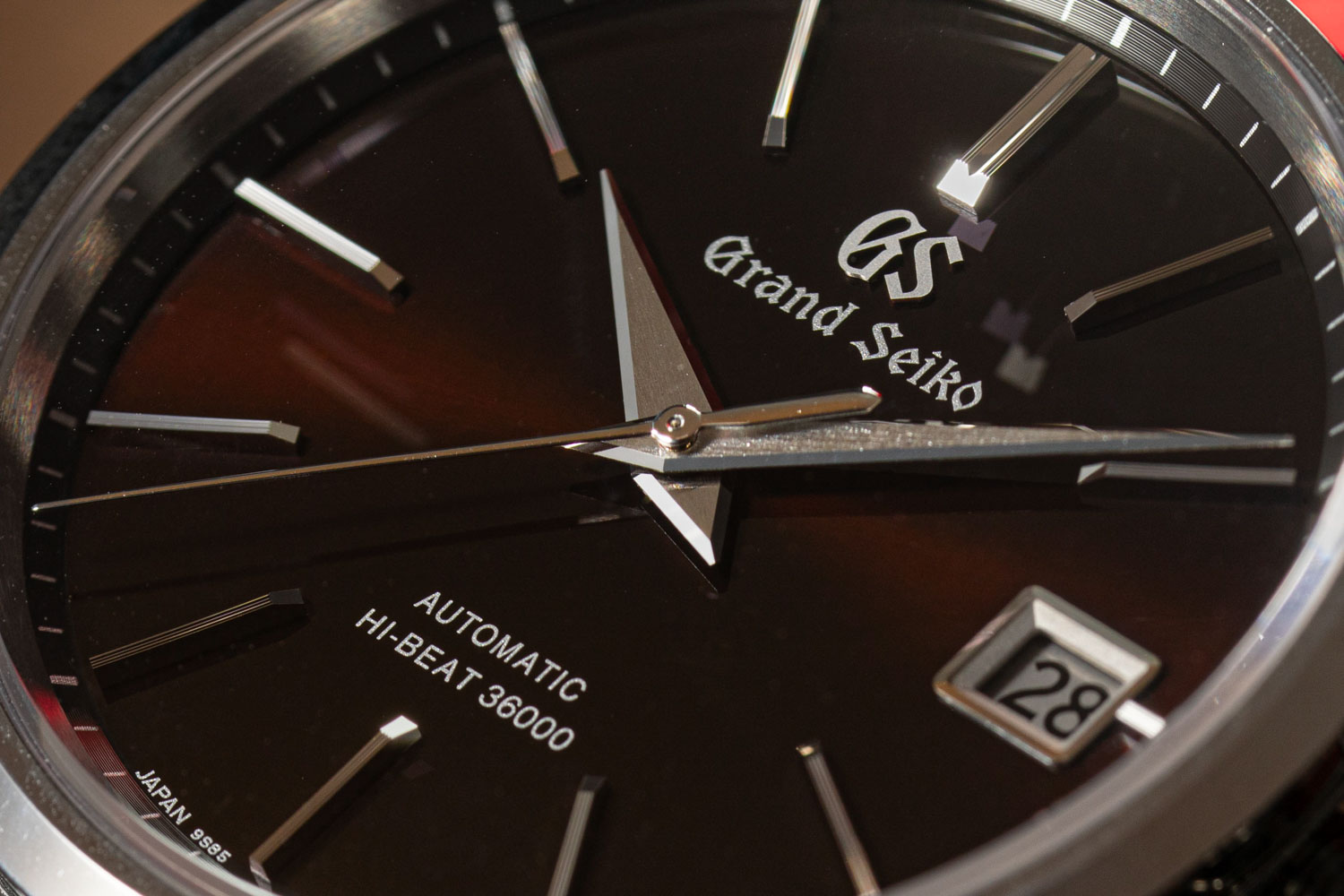The Grand Seiko Hi-Beat SBGH245G with a sunray finish dial that creates an almost constant lightshow on the wrist when outdoors and is a hue that is mid-way between brown and burgundy (©Revolution)