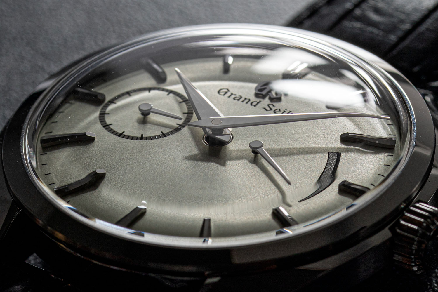The manual wound Grand Seiko SBGK007G is yet another Zen Reductionist timepiece featuring hour, minute, small seconds and power reserve display (©Revolution)