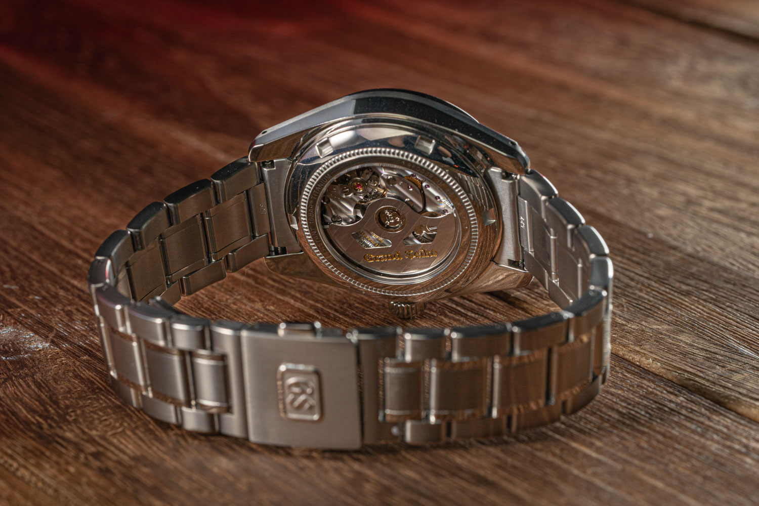 The bracelet on the Grand Seiko Hi-Beat SBGH245G is constructed in the brand's High Impact Titanium as well; the watch is powered by the 9S85 Hi-Beat movement (©Revolution)