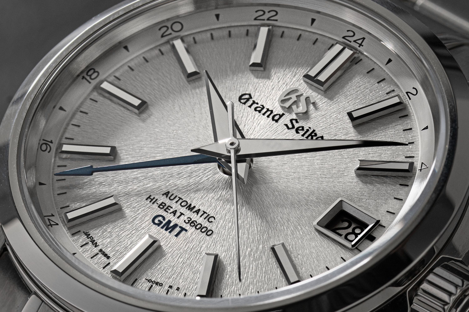 The Grand Seiko Hi-Beat SBGJ201 features a GMT indicator in the form of a 24 hour home time scale, delicately printed at the perimeter of the dial and read off a flame blued arrow tipped hand (©Revolution)