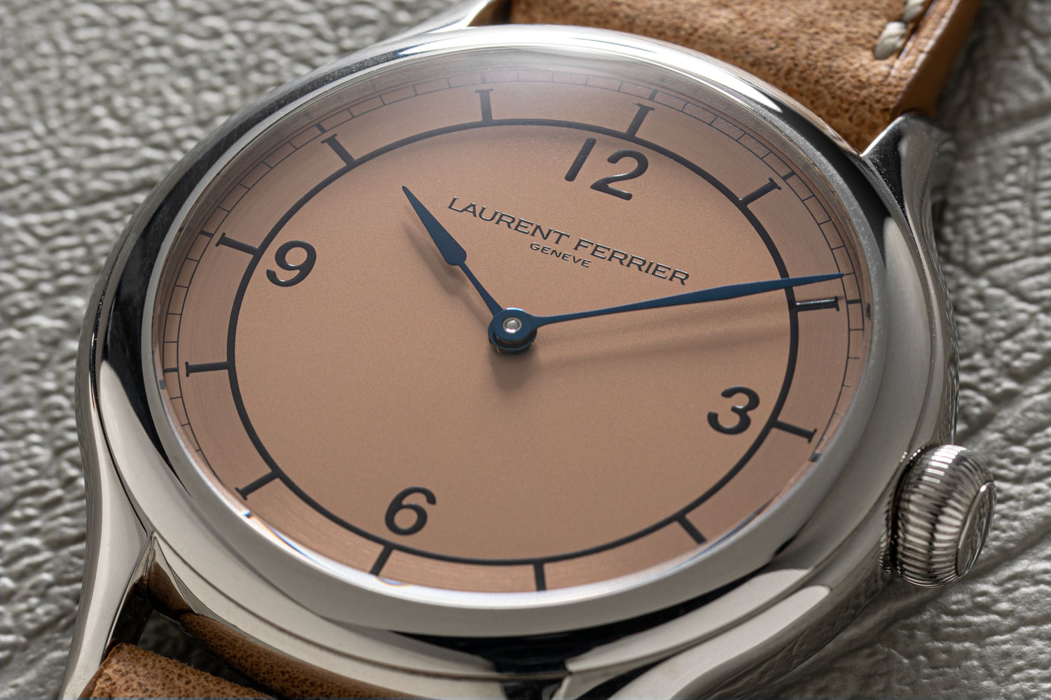The Laurent Ferrier Steel Galet Micro-Rotor Salmon Dial (1-of-1) features a salmon colored dial with a brushed finish on the perimeter of the dial (©Revolution)