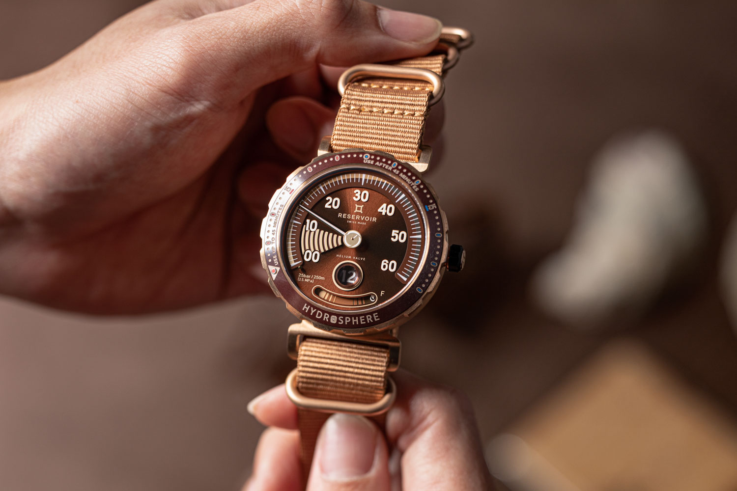 """The Reservoir Hydrosphere Bronze x Revolution """"The Maldives Edition,"""" seen here fitted on ZULU strap with bronze keepers (©Revolution)"""