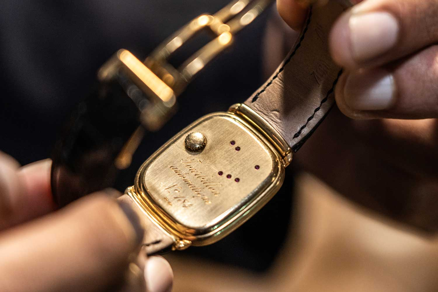 The 1986 Jacqueline Dimier designed Audemars Piguet ultra-thin automatic tourbillon had its crown on the back of the watch; rubies for the gear train pinions are actually visible from the backcase (©Revolution)
