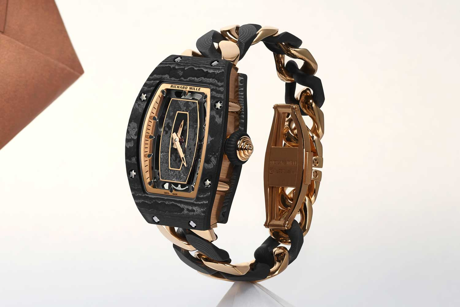 The new RM 07-01 open-link red gold and Carbon TPT bracelet