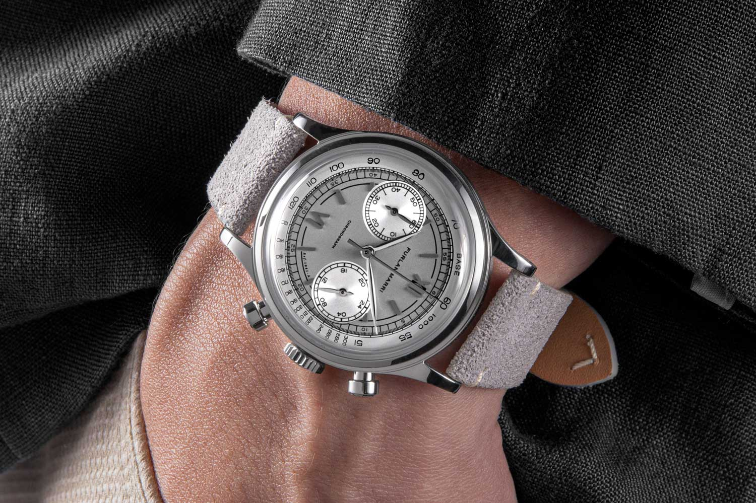 """On the wrist: The 38mm Furlan Marri Ref. 1041-A """"Mr. Grey,"""" inspired by the most collectible and exclusive 50 's watches, with subtle tones of grey and black (©Revolution)"""