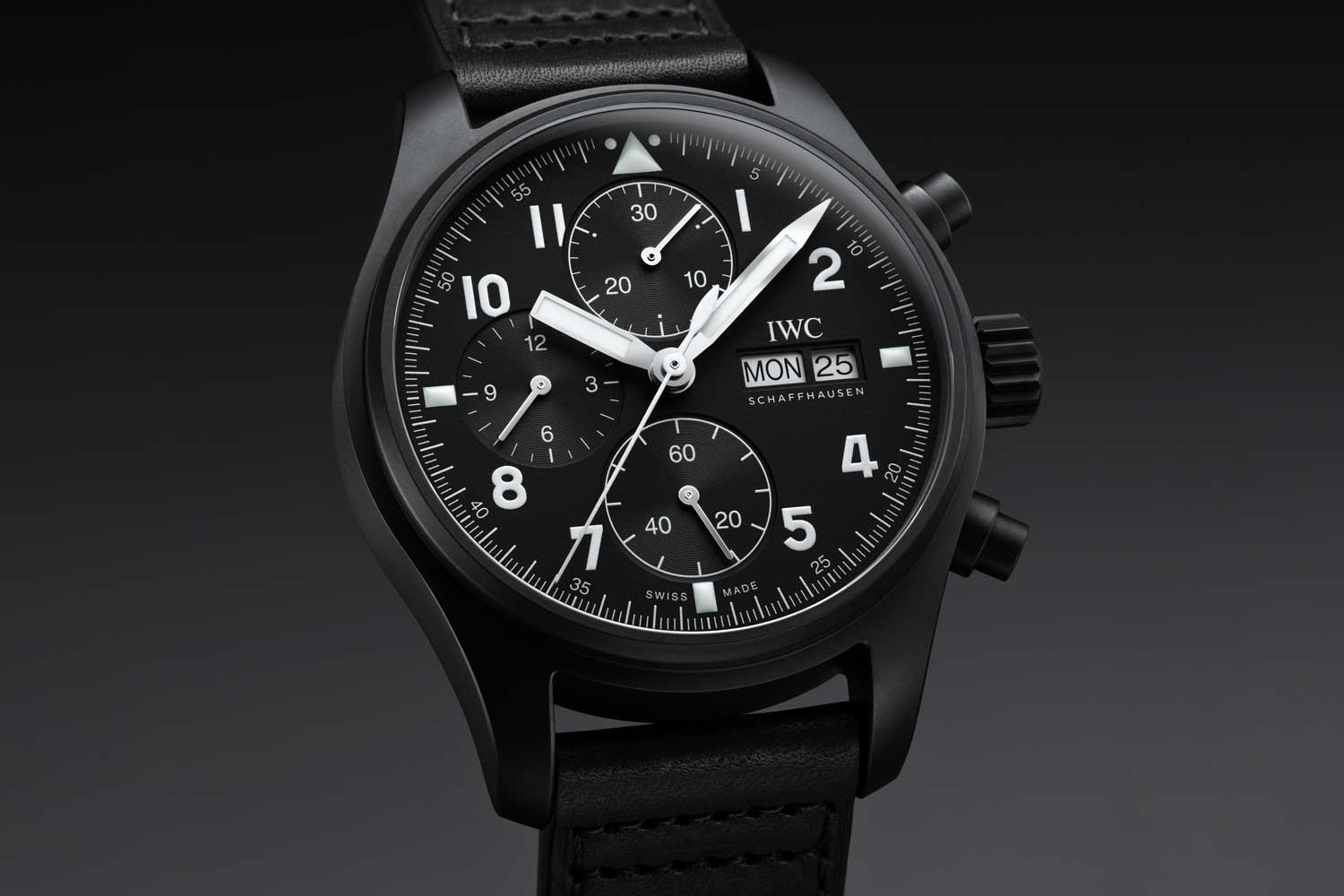 """The watch features the same attributes as the original """"Black Flieger""""—a clean black dial, white painted Arabic numerals and an outer minute/seconds track that features the triangle and two dots at 12 o'clock ."""