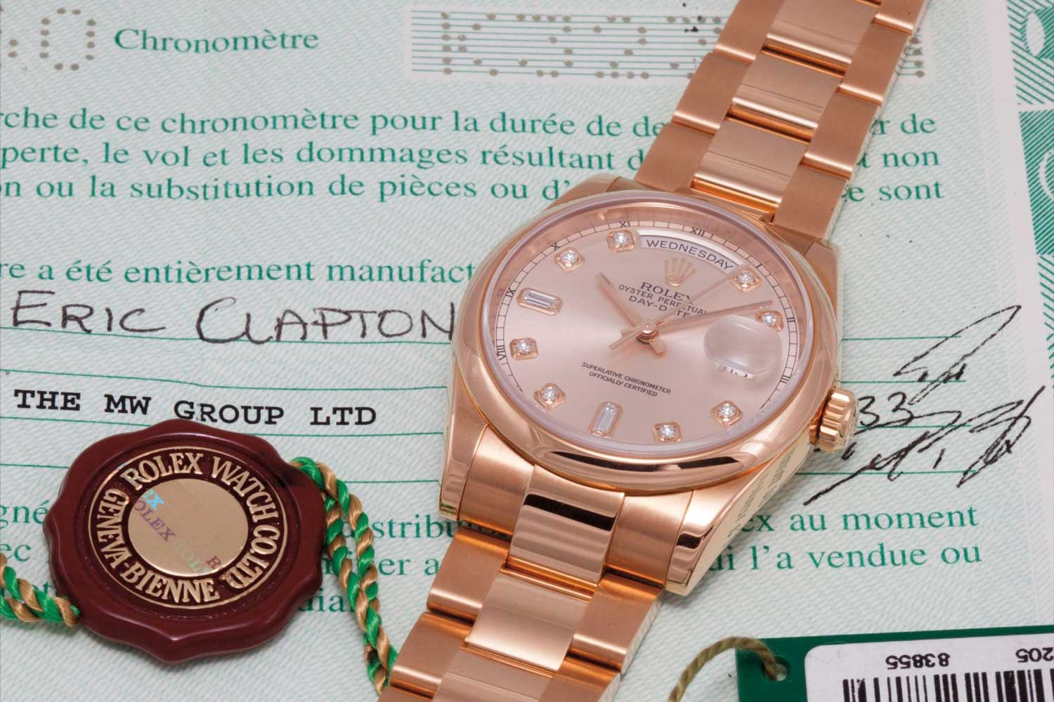 A pink gold and diamond-set calendar wristwatch with centre seconds, and pink dial, formerly in the collection of Sir Eric Clapton. (Image: Phillips)
