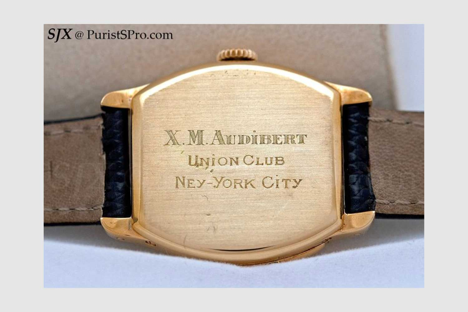 The 1928, Cartier 18K gold tonneau-shaped minute repeating wristwatch that Wei makes reference to above with the Cartier customer's name, his private club and New York city engraved on the back of the watch but with New York spelt wrongly (Image: SJX @ PuristSPro.com)